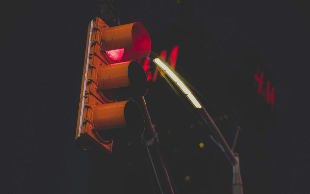 Red traffic light - symbol of slowing down to rest.