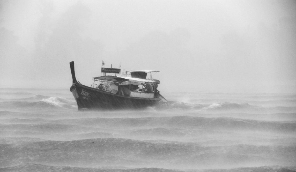 Boat on a stormy sea - symbol of getting frustrated while meditating.