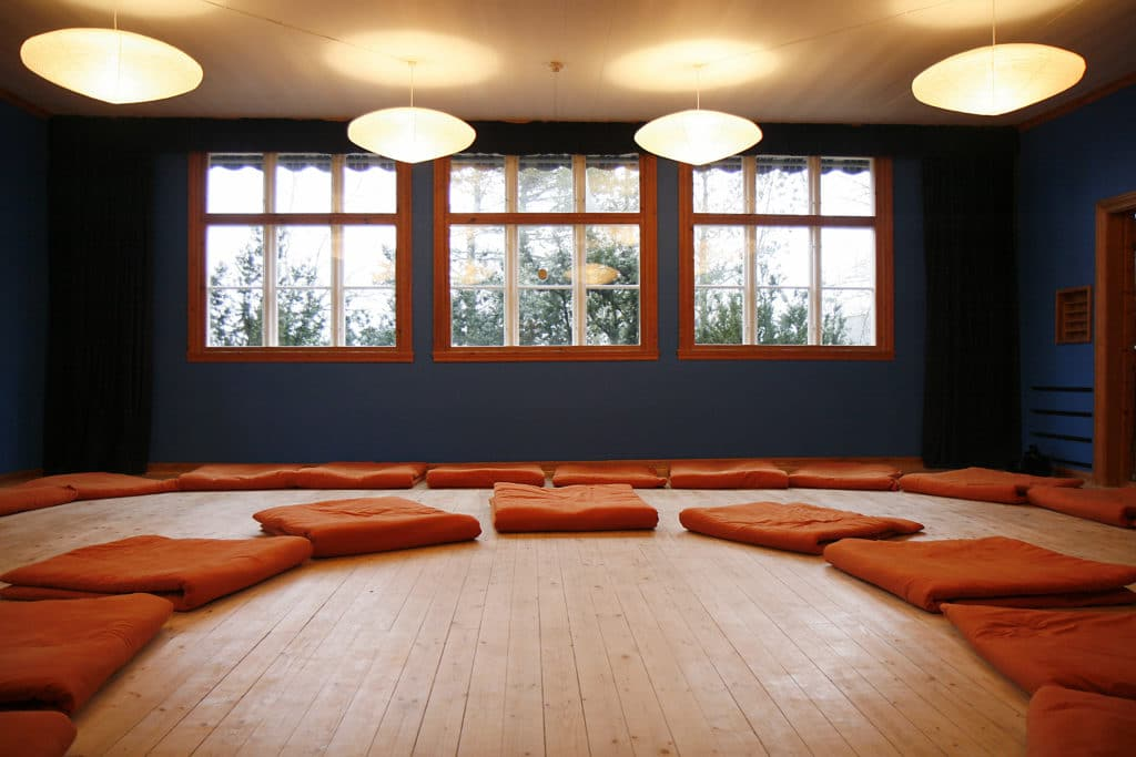 Orange yoga mats in yoga room