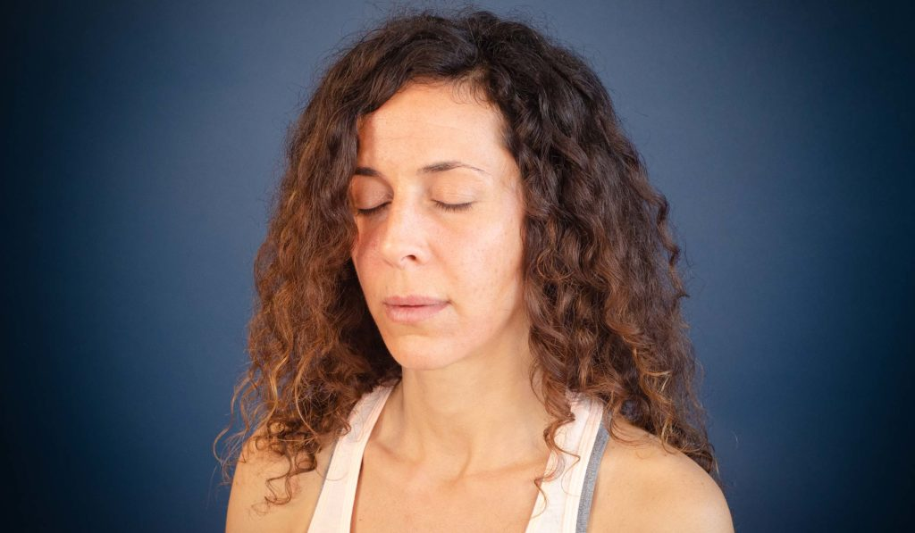 """Woman meditating and wondering """"How do you know you are really meditating""""?"""