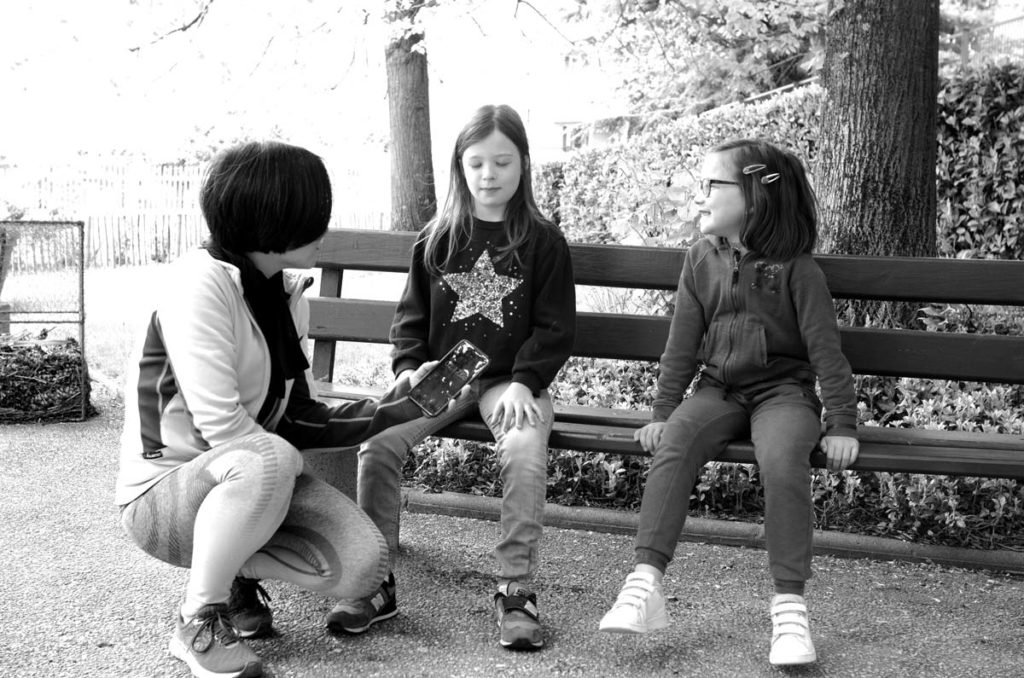 Girls training immobility in a park.