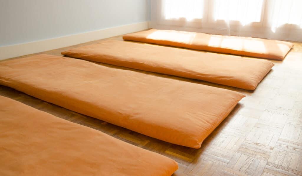 Futon yoga mats in yoga shala.
