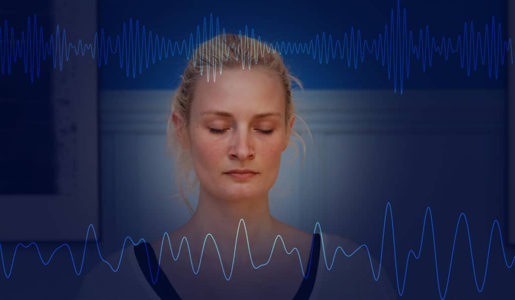 Meditating person with brainwaves