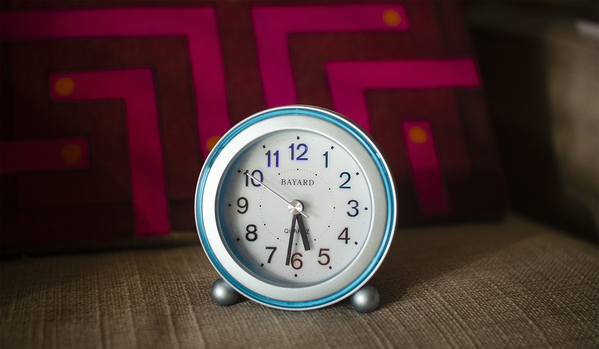 Alarm clock ringing when it's time to get up early for morning yoga.