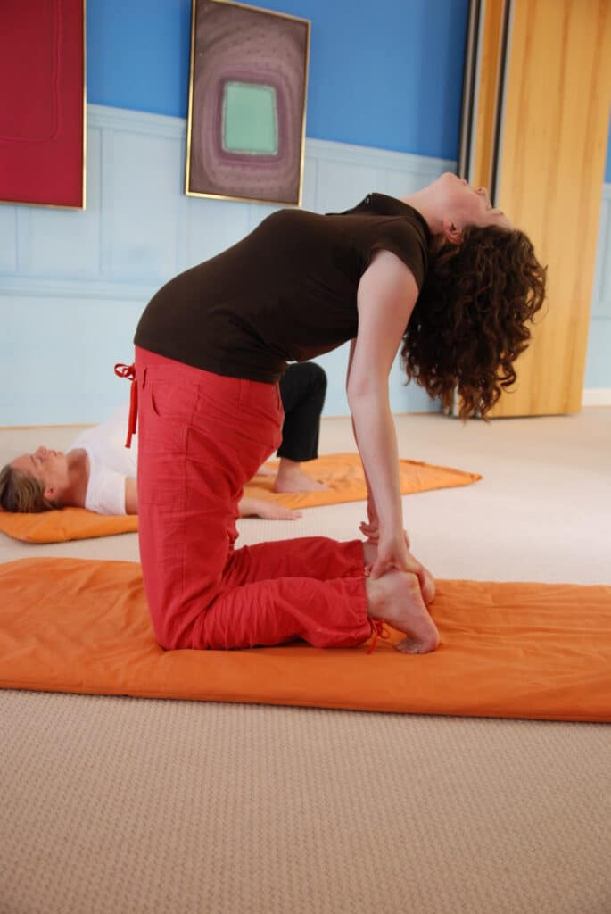 The camel pose during a prenatal yoga class.